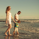 Happy family walking on the beach at the day time. - PhotoDune Item for Sale