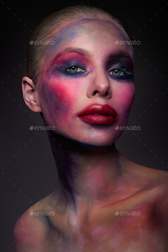 Portrait of the bright beautiful girl with art colorful make-up - Stock Photo - Images