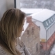 Woman Looking on Snowfall Through Out the Window - VideoHive Item for Sale