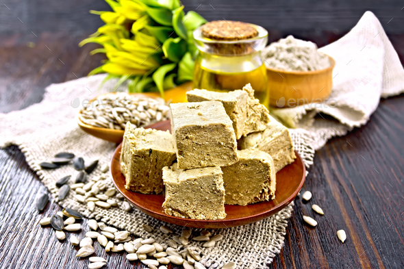 Halva in plate on dark board - Stock Photo - Images