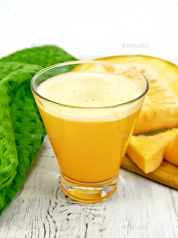 Juice pumpkin with napkin on light board - Stock Photo - Images