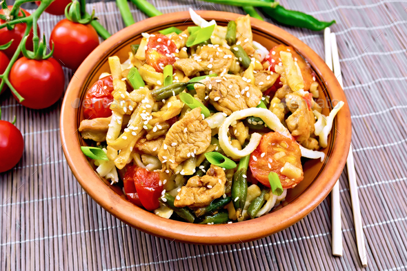 Noodles wok Thai in plate on bamboo - Stock Photo - Images