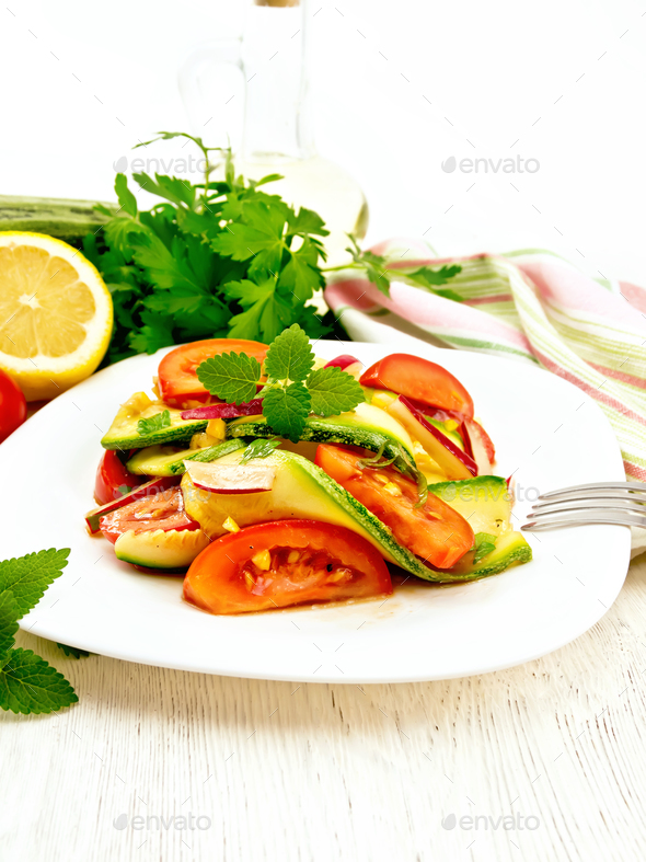 Salad with zucchini and tomato on board - Stock Photo - Images