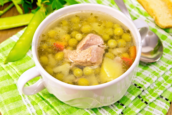 Soup from green peas with meat on napkin - Stock Photo - Images