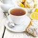 Tea in white cup with lemon cookies on board - PhotoDune Item for Sale