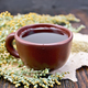 Tea with wormwood in clay cup on board - PhotoDune Item for Sale