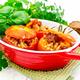 Tomatoes stuffed with bulgur in pan on light board - PhotoDune Item for Sale