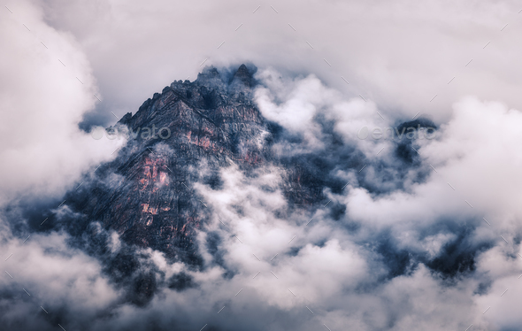 Mountains in clouds in overcast evening in Nepal - Stock Photo - Images