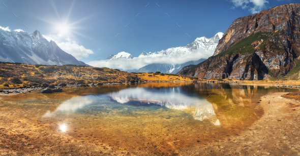 Beautiful view with high rocks with snow covered peaks, mountain lake - Stock Photo - Images
