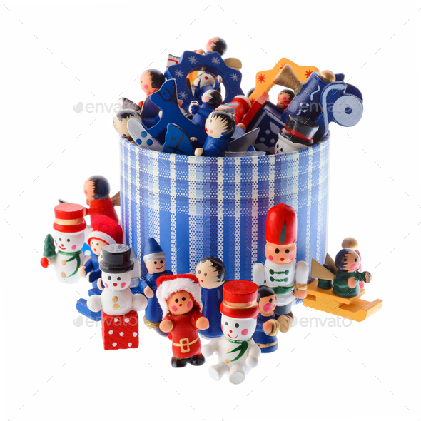 Lot of multicolored Christmas decorations in a blue striped round box - Stock Photo - Images