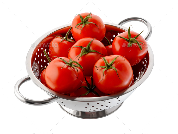 Red tomatoes in a colander - Stock Photo - Images
