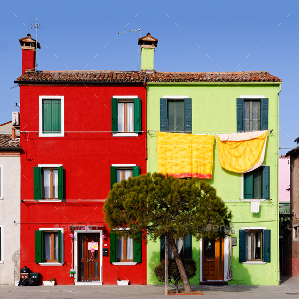 Burano cityscape, green and red houses - Stock Photo - Images
