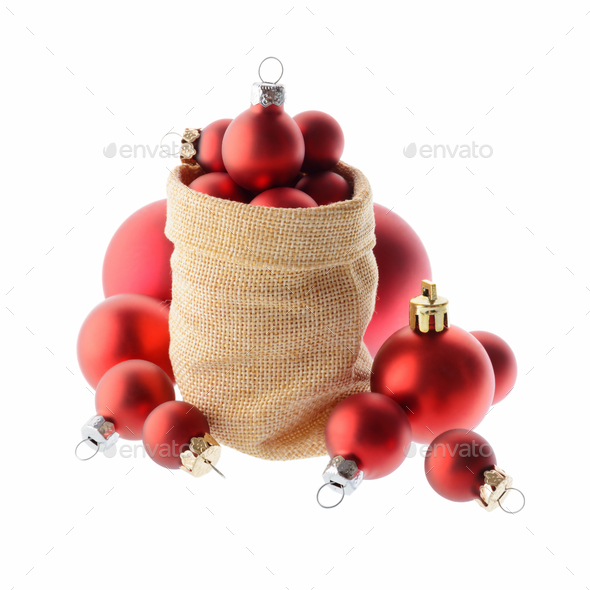 Red Christmas tree balls in a bag of Santa Claus - Stock Photo - Images