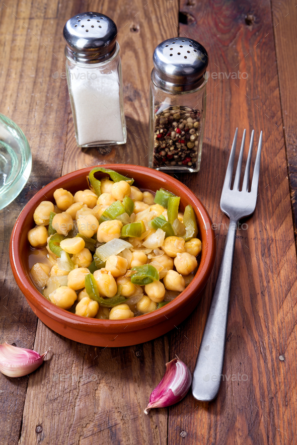 casserole of homemade stewed chickpeas on rustic board - Stock Photo - Images