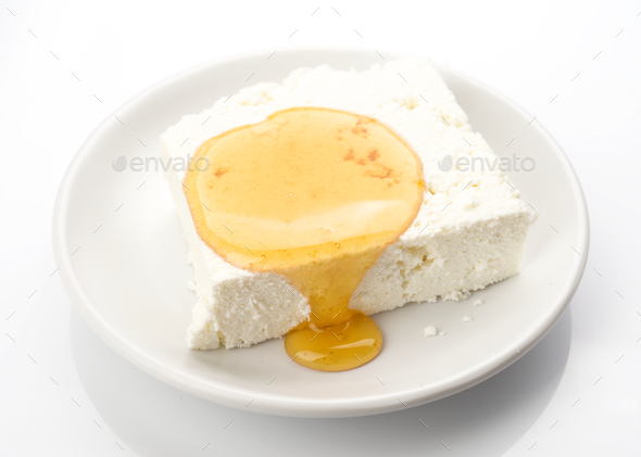 piece of cottage cheese with honey - Stock Photo - Images