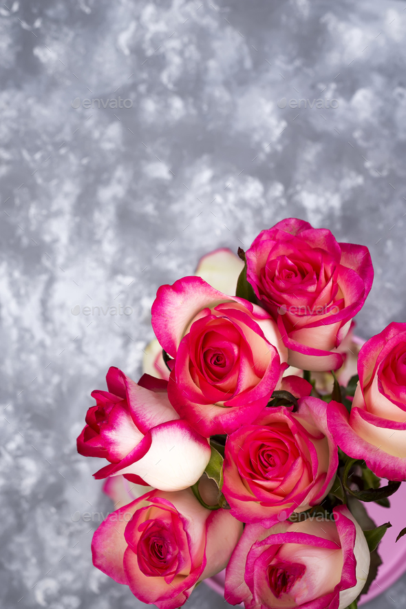 Frame of Red white rose flower bouquet on stone table. - Stock Photo - Images