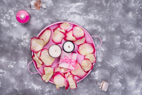 candles with rose petals on pink tray - Stock Photo - Images
