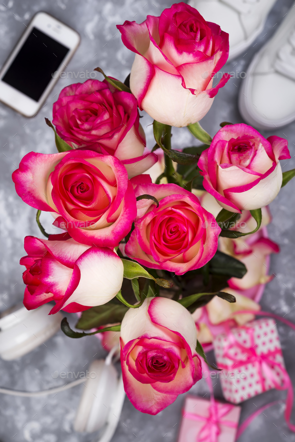 composed of the roses and mobile phone on the back of a blurry background - Stock Photo - Images