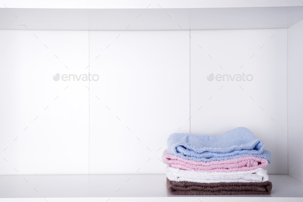 Stack of colorful bath towels on light background - Stock Photo - Images
