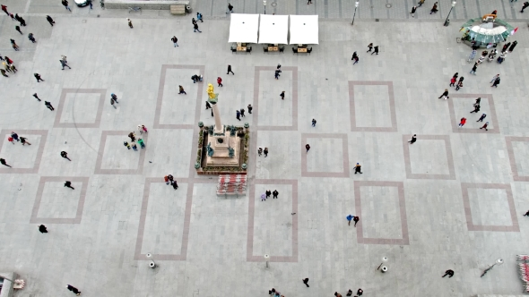 Aerial Of People Walking On Square By Lukassek