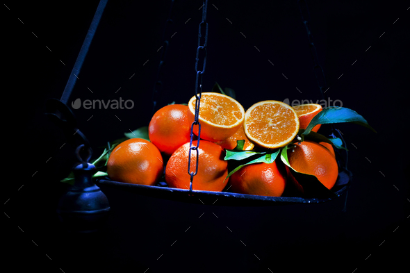 Oranges on scales - Stock Photo - Images