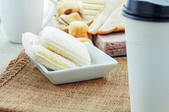 Bread and cup on table - Stock Photo - Images
