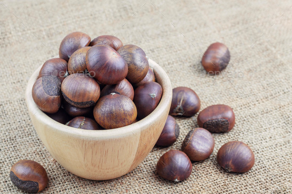 Chestnuts roasted in bowl - Stock Photo - Images