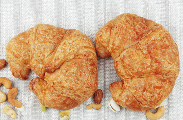 croissants on tablecloth - Stock Photo - Images