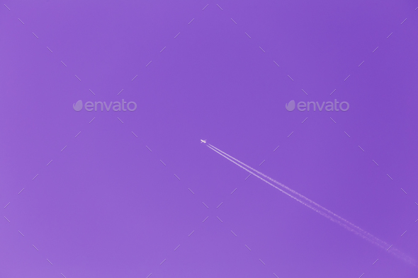 Contrail In Blue Sky. Plane, Clear Sunny Sky Ultra Violet Purple - Stock Photo - Images