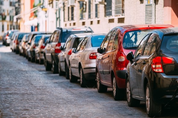 Cars Parked On Street In European City In Sunny Summer Day - Stock Photo - Images