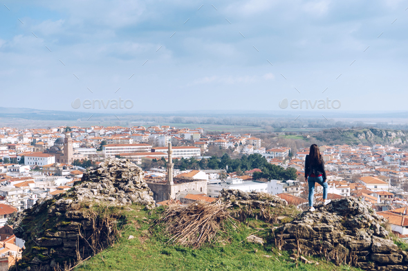 Young girl standing in front of beautiful city view. Panoramic v - Stock Photo - Images