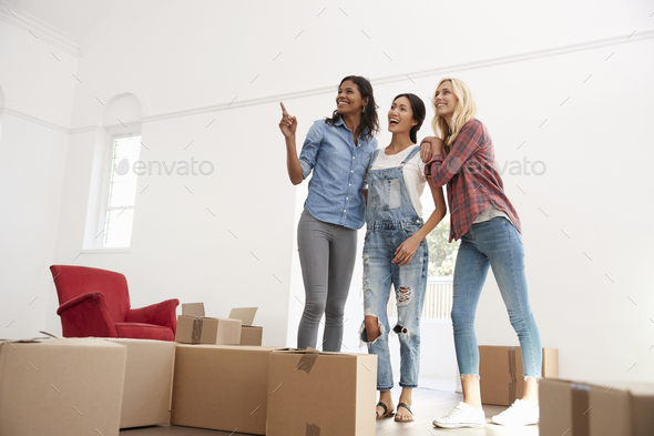 Three Female Friends Moving Into New Home Together - Stock Photo - Images