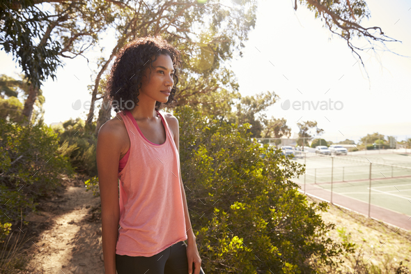 Young black woman taking a break during her run - Stock Photo - Images