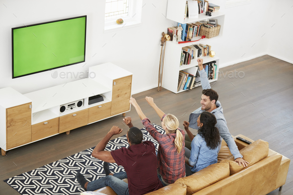Group Of Young Friends Watching Sports On Television And Cheering - Stock Photo - Images