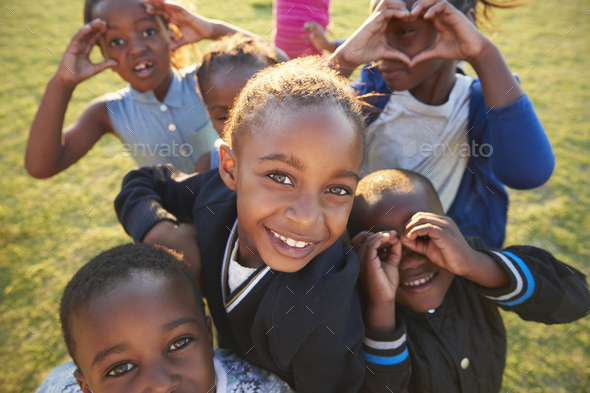 Elementary school kids having fun outdoors, high angle - Stock Photo - Images
