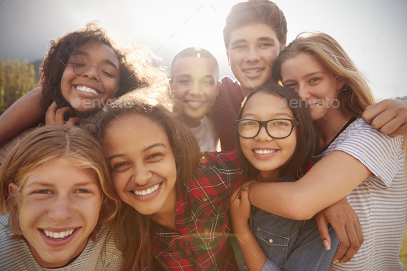 Teenage school friends smiling to camera, close up - Stock Photo - Images