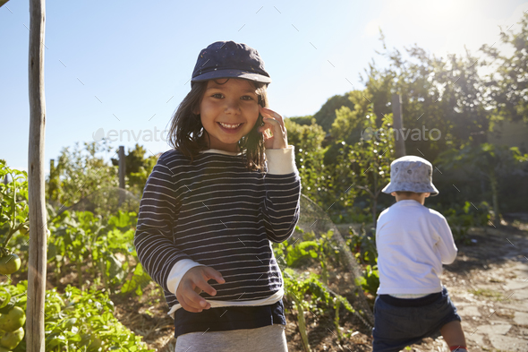 Two Children Playing On Allotment Together - Stock Photo - Images