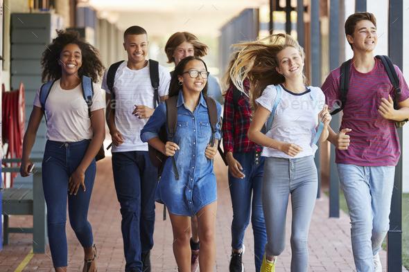 Teenager school kids running in high school hallway - Stock Photo - Images