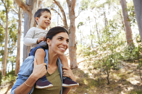 Son Riding On Mother's Shoulders On Countryside Walk - Stock Photo - Images