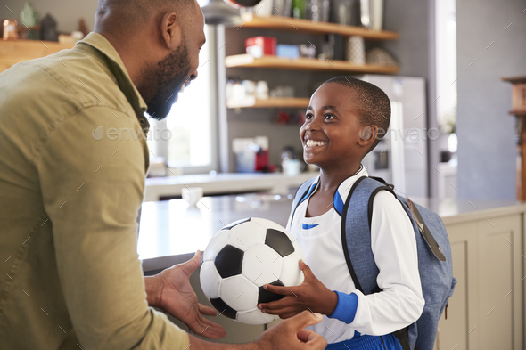 Father Saying Goodbye To Son As He Leaves For School - Stock Photo - Images