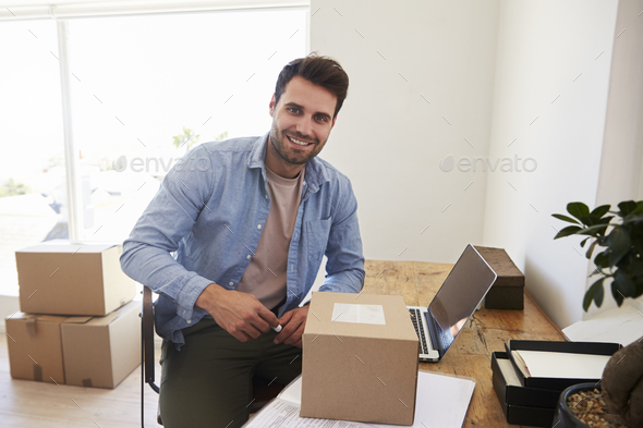 Portrait Of Man In Bedroom Running Business From Home - Stock Photo - Images