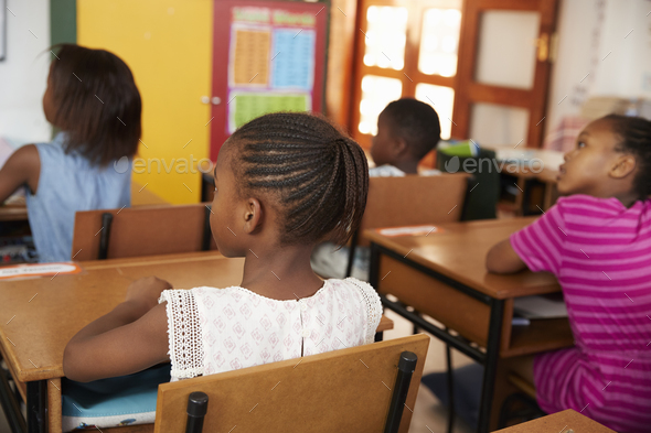 Back view of African kids in an elementary school class - Stock Photo - Images