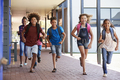 School kids running in elementary school hallway, front view - PhotoDune Item for Sale
