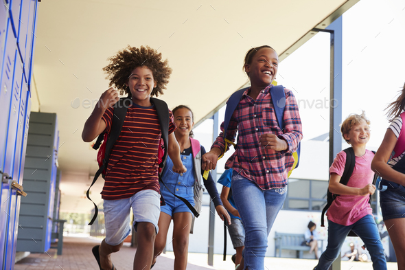 School kids running to camera in school hallway, close up - Stock Photo - Images