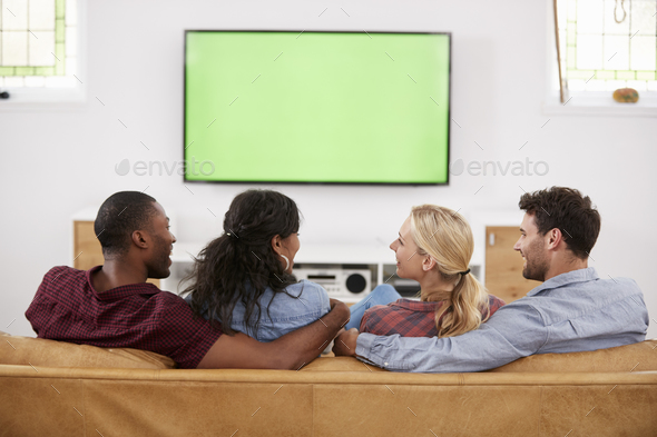 Rear View Of Group Of Young Friends Watching Television Together - Stock Photo - Images