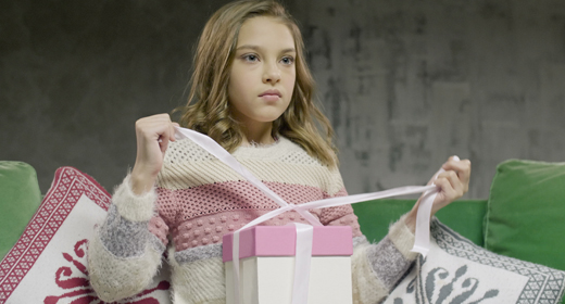 Teenager girl with family and gifts