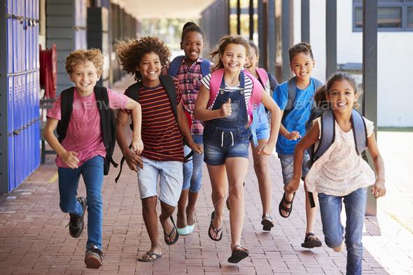 School kids running in elementary school hallway, front view - Stock Photo - Images