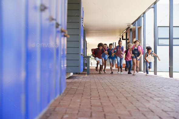 School kids running to camera in elementary school hallway - Stock Photo - Images