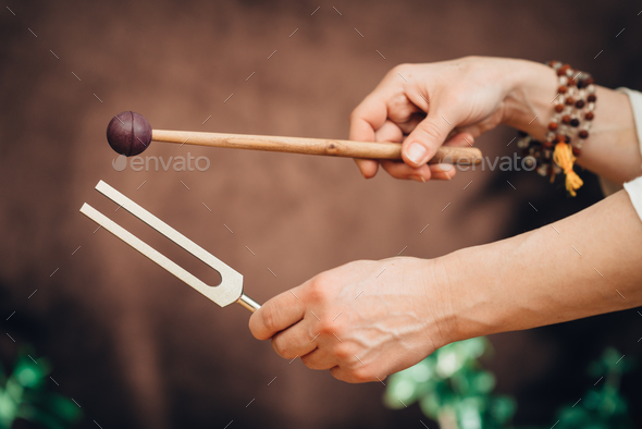 Tuning fork in sound therapy - Stock Photo - Images