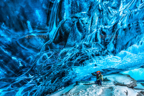 Traveler in the ice cave - Stock Photo - Images